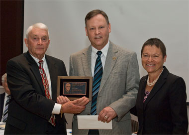 John Erbes, winner of the Lindell W. Sturgis Memorial Public Service Award, and members of the SIU Board of Trustees